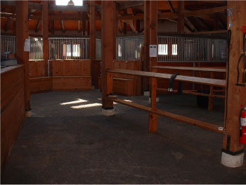 Salvaged rafters, stall posts and beams in Hop Hill barn