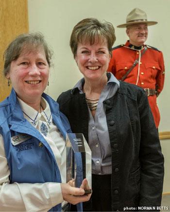 Gayle Ecker holding Builder Award