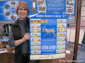 horse owner holding new Horse Health Check poster
