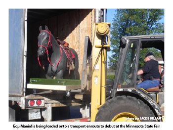 EquiMania! is being loaded onto a transport enroute to debut at the Minnesota State Fair